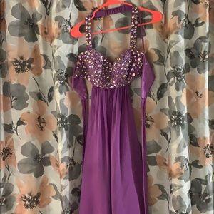 Purple embellished prom dress